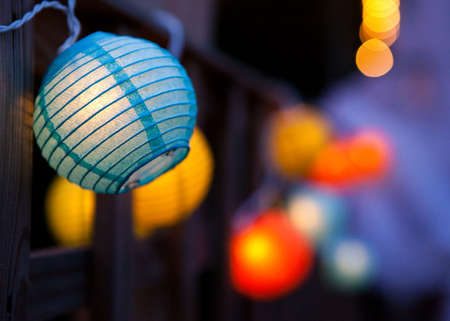 hanging lamp: Small colourful paper lanterns.