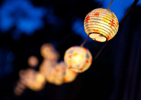lit lamp: Small white paper lanterns. Stock Photo