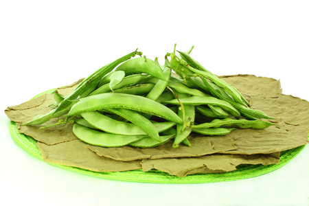 dolichos lablab:  valor papdi beans on dry leaves Stock Photo