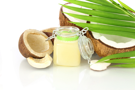 coconut oil with dry coconut and leaves photo