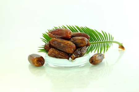 botanical remedy:  dates with leaves Stock Photo