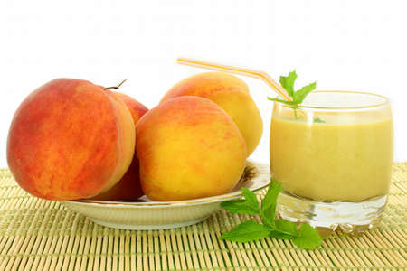 peach fruit and peach milkshake closeup photo