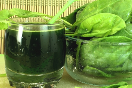fresh spinach and spinach juice closeup photo