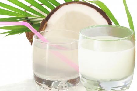 coconut water and coconut milk with cut coconut Standard-Bild