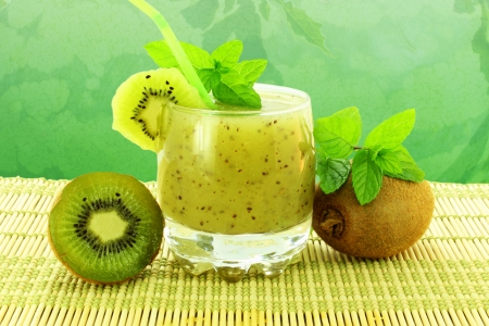 kiwi fruit juice in water melon background closeup