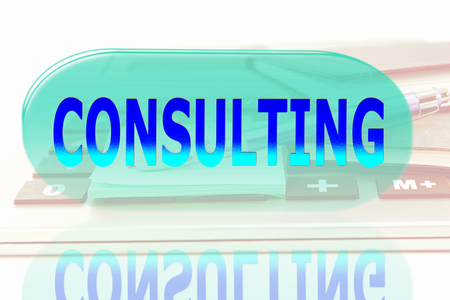 glowing consulting words on office desktop accessories background photo