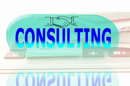 icone: glowing consulting words icone on office desktop accessories background