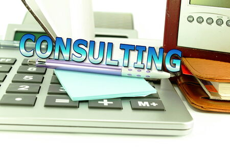 consulting words on office desktop accessories background photo