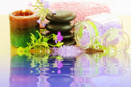 lavender spa tools with water reflection