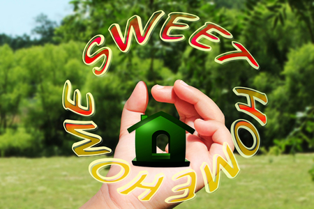 home sweet home icon design on hand photo