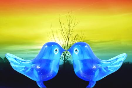 art and craft: bluebird lovebird glass art craft in sunrise backgrounnd