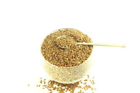 flax seed: flax seed  with spoon in pure white background