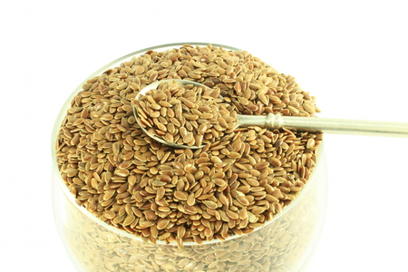 organic flax seed: flax seed with spoon  closeup in pure white background