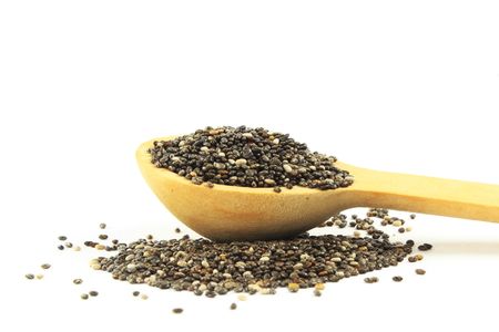 chia seeds in wooden spoon in white  background