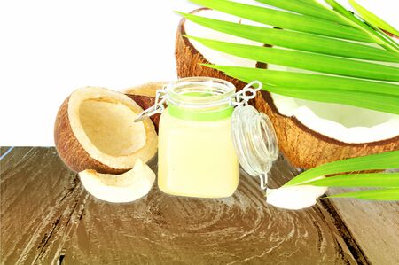 coconut oil with cut coconut and leaf Фото со стока