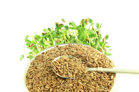 flax seed whole and sprouted in pure white background