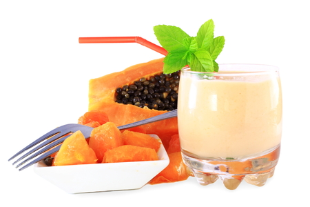 papaya milkshake with cut papaya and mint in pure white background