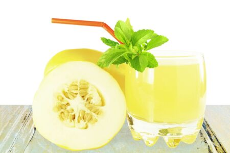 Korean melon fruit juice with stevia herb in pure white background Stock Photo