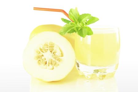 Korean melon fruit juice with stevia herb in pure white background Standard-Bild