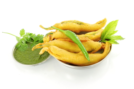 chili  pakoda or fritter indian food snack in pure white background