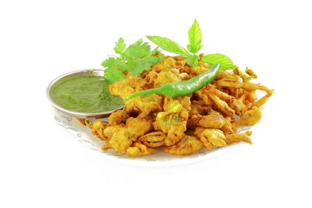 methi: methi vada pakoda or fritter indian food snack in pure white background Stock Photo