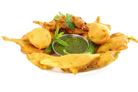 methi: potato vada mix pakoda or fritter indian food snack in pure white background