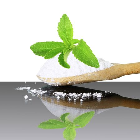 cures: fresh green Stevia and extract powder on white background