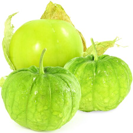 husk tomato: tomatillo or mexican green tomato fruit or vegetable in white background Stock Photo