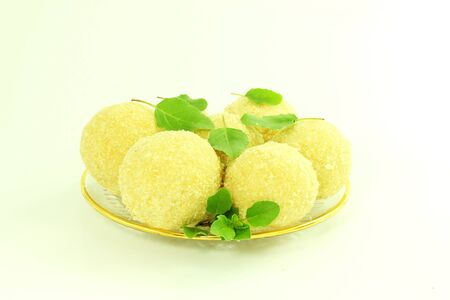 indian cookery: traditional Indian sweets laddu or ladu in white background Stock Photo