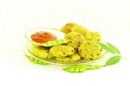 indian bean: tuvar bean or pigeon pea pakoda thepla vada fritter indian gujrati food snack Stock Photo