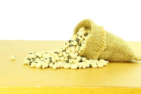 cow pea: Black eye peas beans in jute bag in white background Stock Photo