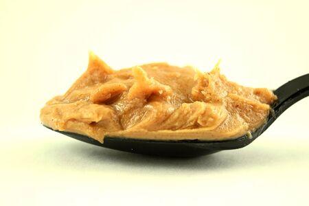 peanut butter: peanut butter  in spoon closeup Stock Photo