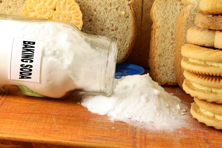 neutralizer: baking soda in a glass jar  with cookie and bread