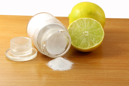 sodium hydrogen carbonate: baking soda or baking powder in glass bottle with lemon fruit