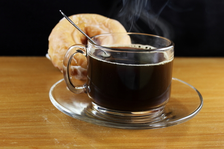 coffee cup with steam and donut closeup Zdjęcie Seryjne