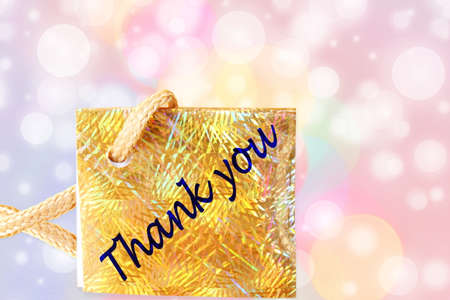 de focused: thank you letter tag or label with de focused circles background Stock Photo