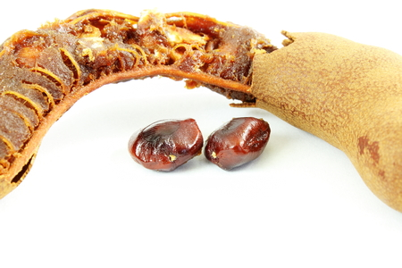 Tamarind with seeds closeup on white background
