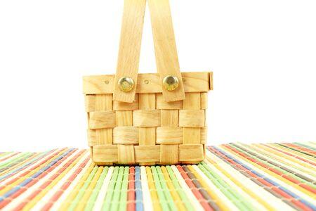 bamboo mat: bamboo basket on white background on bamboo mat Stock Photo