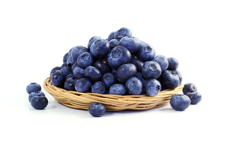 plant antioxidants: blueberries in bamboo basket on white background