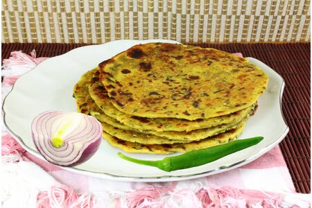 methi: indian food Methi Paratha or thepla flat bread with fenugreek leaves and spices