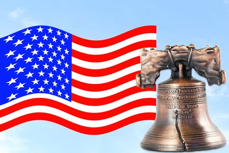 liberty bell: us or American flag waving in blue sky with idol liberty bell