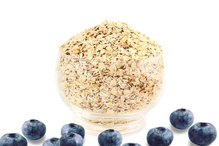 oatmeal bowl: oatmeal in bowl with blueberry on white background