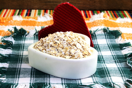 oatmeal bowl: Dry rolled oatmeal flakes  in heart shape bowl with heart