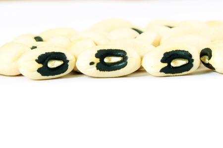 cow pea: Black eye beans in white background closeup Stock Photo