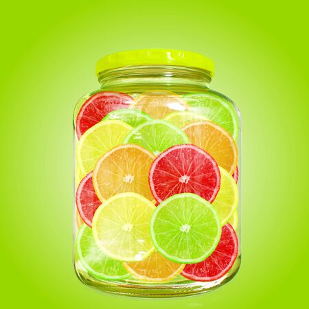 multi color: Multi color different citrus slices in bottle jar Stock Photo