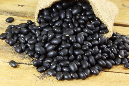 black beans: dry black beans in jute bag Stock Photo