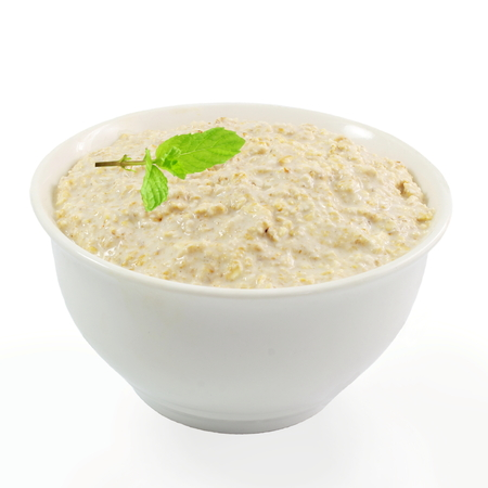 oatmeal bowl: oatmeal porridge in bowl with mint in white background