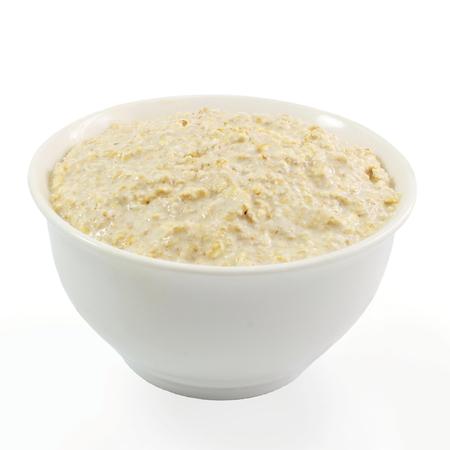 wild oats: oatmeal porridge in bowl in white background