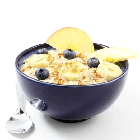 oatmeal bowl: oatmeal porridge in bowl in white background