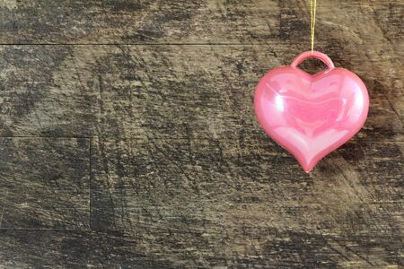 pink heart: pink heart icon on old wooden background